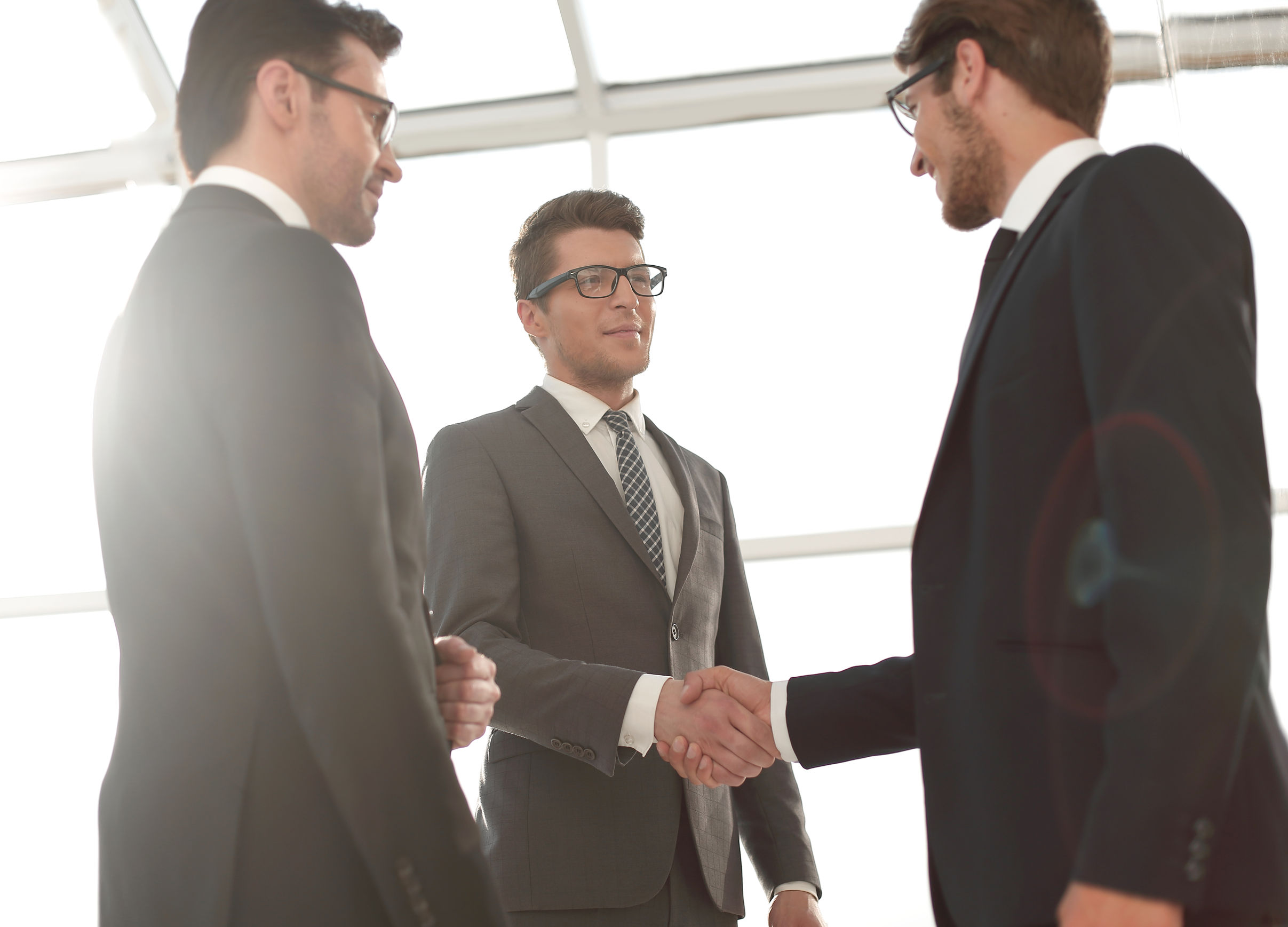 105287657 - close up.young businessman shaking hands with investor